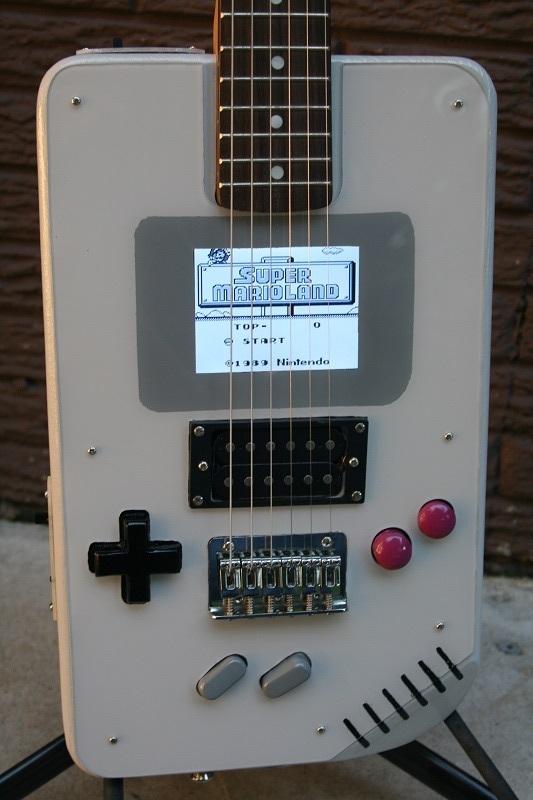 raspberry pi retro game boy plays like a guitar