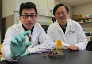 Percival Zhang (right) and Zhiguang Zhu, with a sugar fuel cell