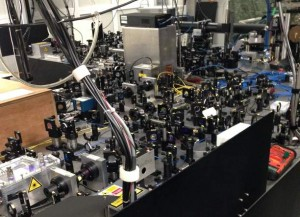 Chip-scale ion trap on an optical bench