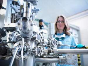 STFC's Dr Emma Springate, one of the research team, with the Artemis laser  (Credit: Monty Rakusen Photography)