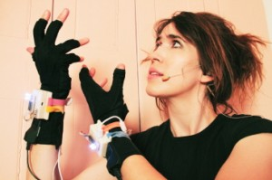 Imogen Heap wearing the Wi-Fi musical gloves