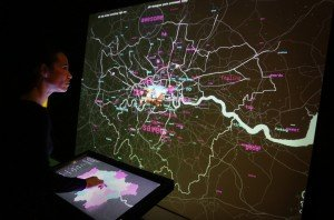A curator checks exhibits in Big Bang Data at Somerset House on December 2, 2015 in London, England