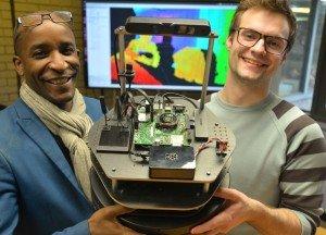 Pasi and Ariel holding Hugh - Robot librarian to stalk Aberystwyth University