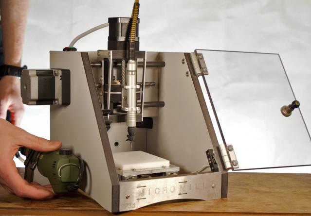 Mini-CNC mill sits on A4 sheet