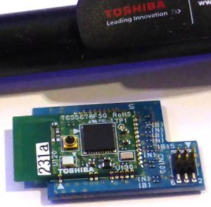 Toshiba bluetooth module next to a pen