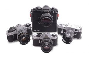 selection of older SLR cameras one fitted with I'm Back - Digital rescue for analogue SLR cameras